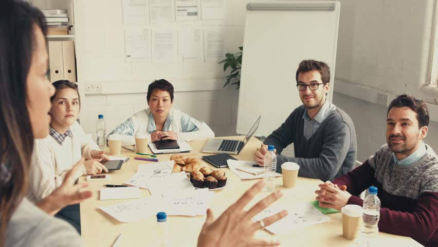 Employees learning new information in a meeting